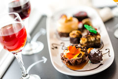 Tasting of wine and pattie chocolate pastries at the chocolate. Stock Photo