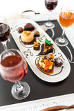 Tasting of wine and pattie chocolate pastries at the chocolate. Royalty Free Stock Images