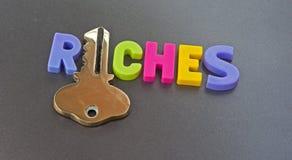 Tasto alle ricchezze Immagini Stock Libere da Diritti