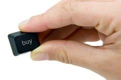 Tasto del buy della holding della mano Fotografia Stock Libera da Diritti
