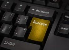 Tasto del computer dorato di successo Immagini Stock