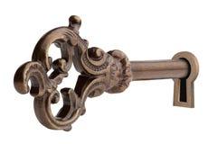 Tasto dell'annata in buco della serratura. Fotografie Stock