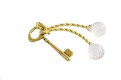 Tasto dell'oro con l'anello portachiavi di cristallo Fotografie Stock