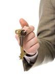 Tasto della holding della mano dell'uomo d'affari a successo Immagini Stock Libere da Diritti