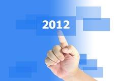 Tasto di spinta 2012 della mano Immagine Stock Libera da Diritti