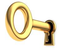 Tasto dorato in buco della serratura Fotografie Stock Libere da Diritti
