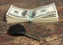 Tasto e soldi Immagini Stock Libere da Diritti