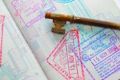 Tasto sul passaporto in pieno dei bolli Fotografia Stock Libera da Diritti