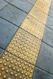 Tastpflasterung für blindes Handikap Stockfotos