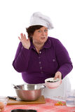 This is so tasty!. Happy chef making a good tasting gesture with a bowl in her hands Stock Photography
