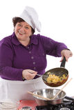 It is so tasty!. Female chef showing the inside of her frying pan with scrambled egg Royalty Free Stock Photography