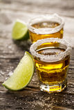 Tasty alcohol drink cocktail tequila with lime and salt on vibra Royalty Free Stock Photography