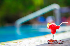 Tasty alcoholic cocktail background swimming pool Stock Photos