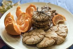 Tasty almond cookies on a wooden plate surrounded. By autumn leaves Stock Photography