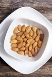 Tasty Almond in White Bowl Royalty Free Stock Image
