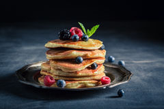 Tasty american pancakes with maple syrup and berries Royalty Free Stock Photography