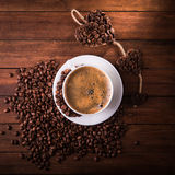 Tasty americano coffee with beans Stock Photo