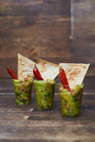 Tasty appetizer with green salad decorated with red piper and pi Royalty Free Stock Images