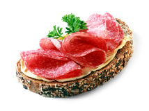 Tasty appetizer of salami on wholewheat bread Stock Photography