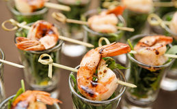 Tasty appetizer of shrimps and arugula Stock Photos