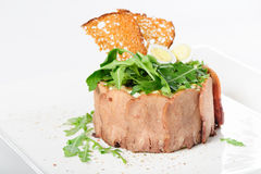 Tasty appetizer with sliced veal tongue and riuccola Royalty Free Stock Photo
