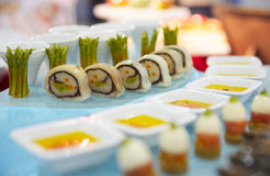 Tasty appetizers on banquet table Stock Photo
