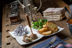 Tasty appetizers with chicken liver pate, valerian salad, toaste Stock Photo