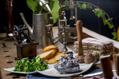 Tasty appetizers with chicken liver pate, valerian salad, toaste Royalty Free Stock Photos