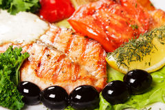 Tasty and appetizing fish grill with olives Royalty Free Stock Photos