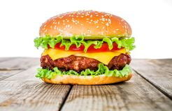 Tasty and appetizing hamburger cheeseburger. American Stock Photos