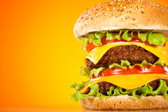 Tasty and appetizing hamburger on a yellow Royalty Free Stock Photos