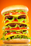 Tasty and appetizing hamburger on a yellow Royalty Free Stock Photography
