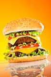 Tasty and appetizing hamburger on a yellow Stock Photography