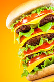 Tasty and appetizing hamburger on a yellow Royalty Free Stock Images