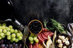 Tasty appetizing italian Mediterranean Food Ingredients Flat Lay. On Dark Old Black Background Top View Copy Space Above Stock Image