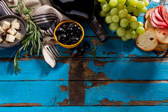 Tasty appetizing italian Mediterranean Greek Food Ingredients Wi. Tasty appetizing italian Mediterranean Food Ingredients Flat Lay on Blue Old Rustic Background Royalty Free Stock Photos