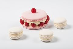 Tasty appetizing macaron ispahan  with fresh berries raspberry bilberry Royalty Free Stock Photo
