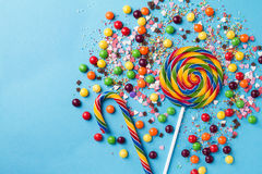 Tasty appetizing Party Accessories on Bright Blue Background. Tasty appetizing Party Accessories Happy Birthday Sweet Treat Swirl Balloon Candy Lollypop Colorful Royalty Free Stock Photo
