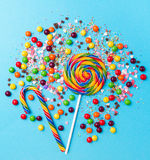 Tasty appetizing Party Accessories on Bright Blue Background. Tasty appetizing Party Accessories Happy Birthday Sweet Treat Swirl Balloon Candy Lollypop Colorful Stock Image