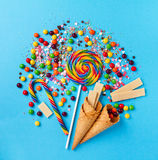 Tasty appetizing Party Accessories on Bright Blue Background. Tasty appetizing Party Accessories Happy Birthday Sweet Treat Swirl Balloon Candy Lollypop Colorful Royalty Free Stock Photos