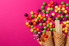 Tasty appetizing Party Accessories on Bright Pink Background. Tasty appetizing Party Accessories Happy Birthday Sweet Treat Swirl Balloon Candy Lollypop Colorful Stock Photography