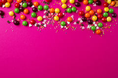 Tasty appetizing Party Accessories on Bright Pink Background. Tasty appetizing Party Accessories Happy Birthday Sweet Treat Swirl Balloon Candy Lollypop Colorful Royalty Free Stock Photo
