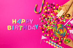 Tasty appetizing Party Accessories Happy Birthday on Bright Pink. Tasty appetizing Party Accessories Happy Birthday Sweet Treat Swirl Candy Lollypop Colorful Stock Image