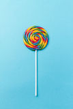 Tasty appetizing Party Accessory Sweet Swirl Candy Lollypop on B. Tasty appetizing Party Accessory Sweet Treat Swirl Candy Lollypop on Bright Background Top View Royalty Free Stock Photos