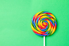 Tasty appetizing Party Accessory Sweet Swirl Candy Lollypop on G Stock Image