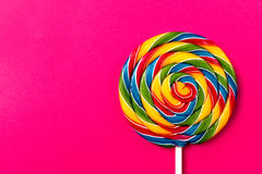 Tasty appetizing Party Accessory Sweet Swirl Candy Lollypop on P. Tasty appetizing Party Accessory Sweet Treat Swirl Candy Lollypop on Bright Background Top View Royalty Free Stock Image