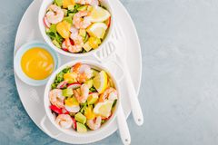 Salad with prawns in bowls on table Royalty Free Stock Images