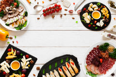 Tasty appetizing snacks, flat lay, copy space Royalty Free Stock Image