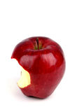 Tasty Apple. Red apple with a bite taken out of it on a white background Stock Photos