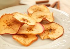 Tasty apple chips. On plate stock photography